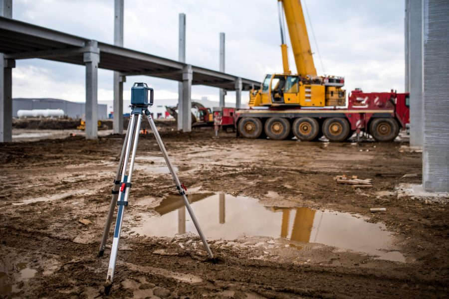 Industrial engineering with theodolite, gps, total station and tools at construction site outdoors during surveying work