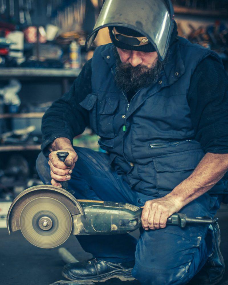 metal-grinding-on-steel-spare-part-in-workshop-P7MPKL8.jpg